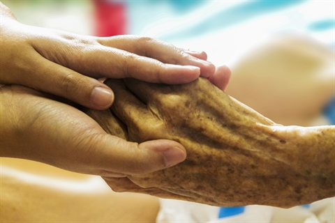 Holding an Elderly Hand with Care.jpg