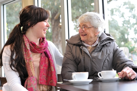 Elderly lady in cafe with support worker