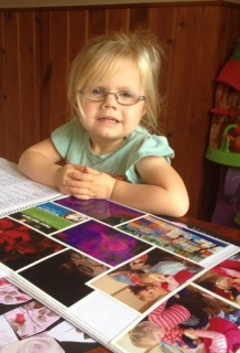FDC Child reading her portfolio book.jpg