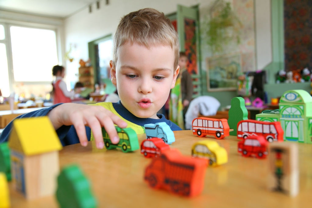Boy playing with transport toys
