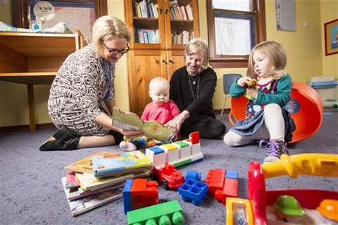 Maternal-and-Child-Health-nurse-playing-with-babies-and-mum
